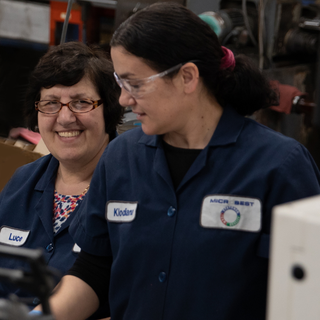 Microbest employees smiling while working.