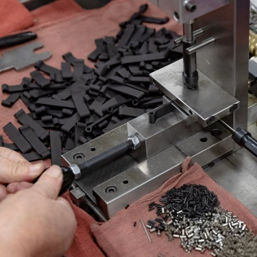 Metal components being created with Microbest Precision machinery.