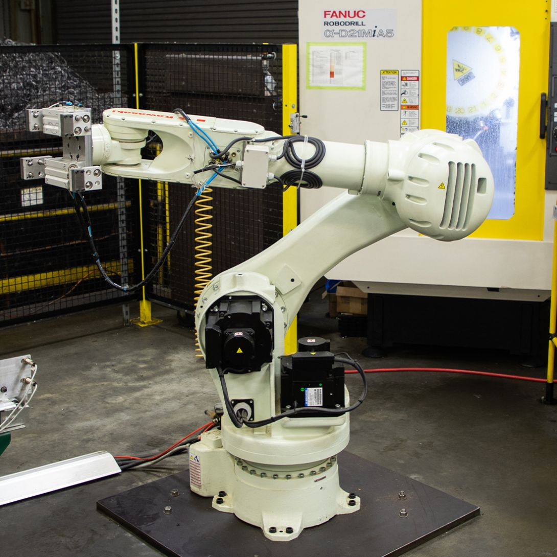 A white Microbest Precision machine on the factory floor.